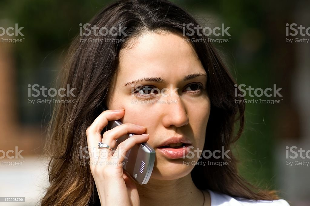 Pretty Young Woman with Flip Phone royalty-free stock photo