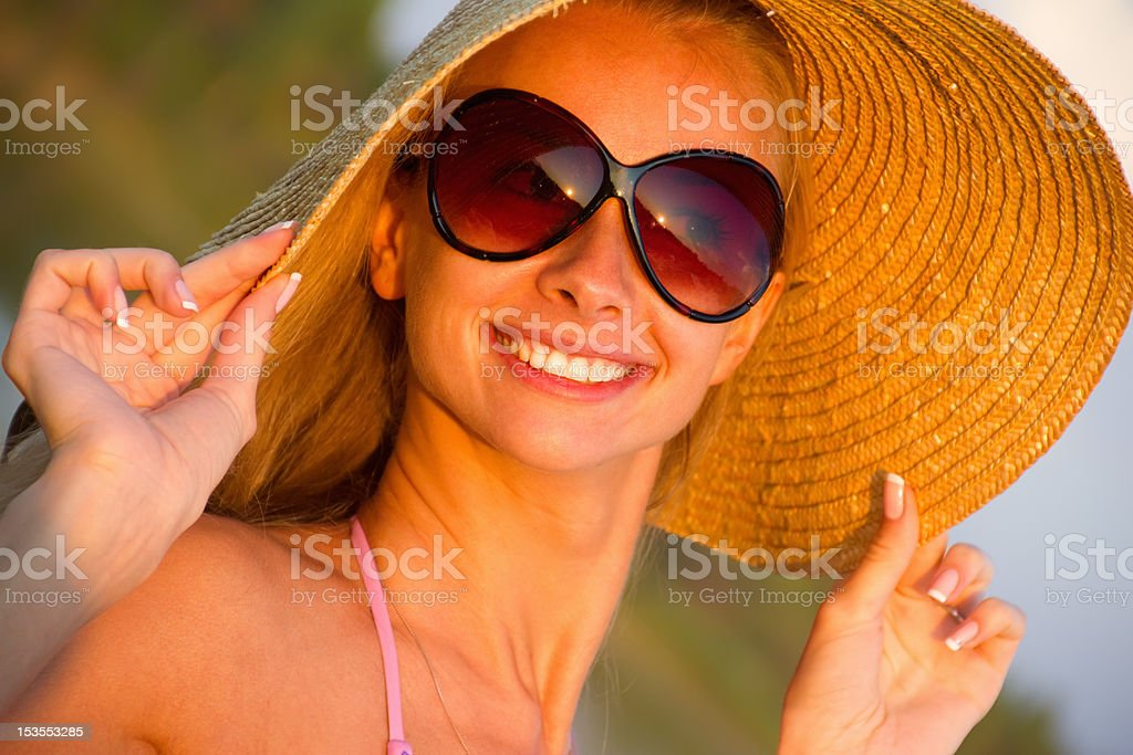 Pretty young woman with hat royalty-free stock photo