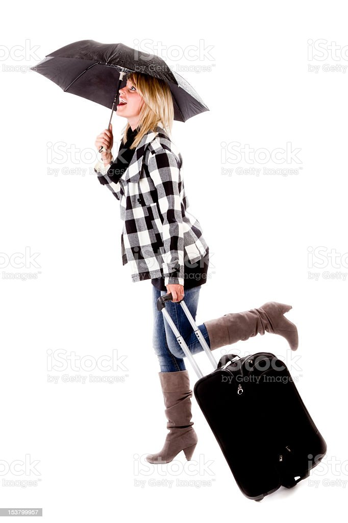 Pretty Young Woman with Rolling Suitcase and Umbrella, Isolated stock photo
