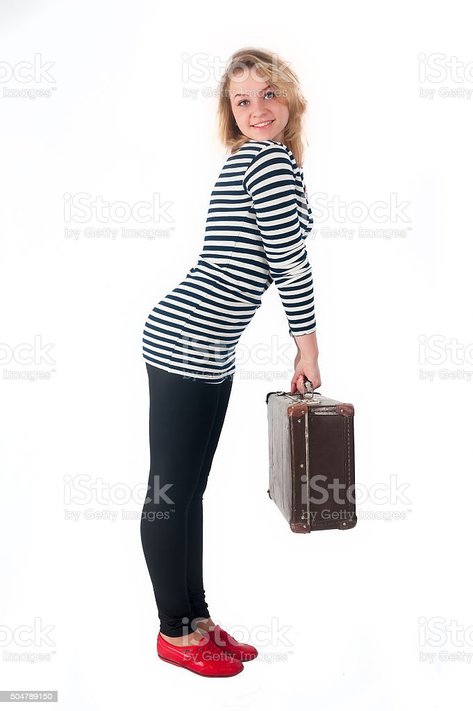 Pretty young woman with suitcase stock photo