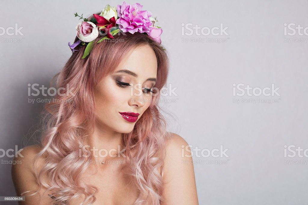 Pretty young woman with Wreath of Pink Flowers stock photo