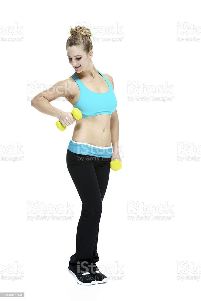 Pretty young woman working out with weights stock photo