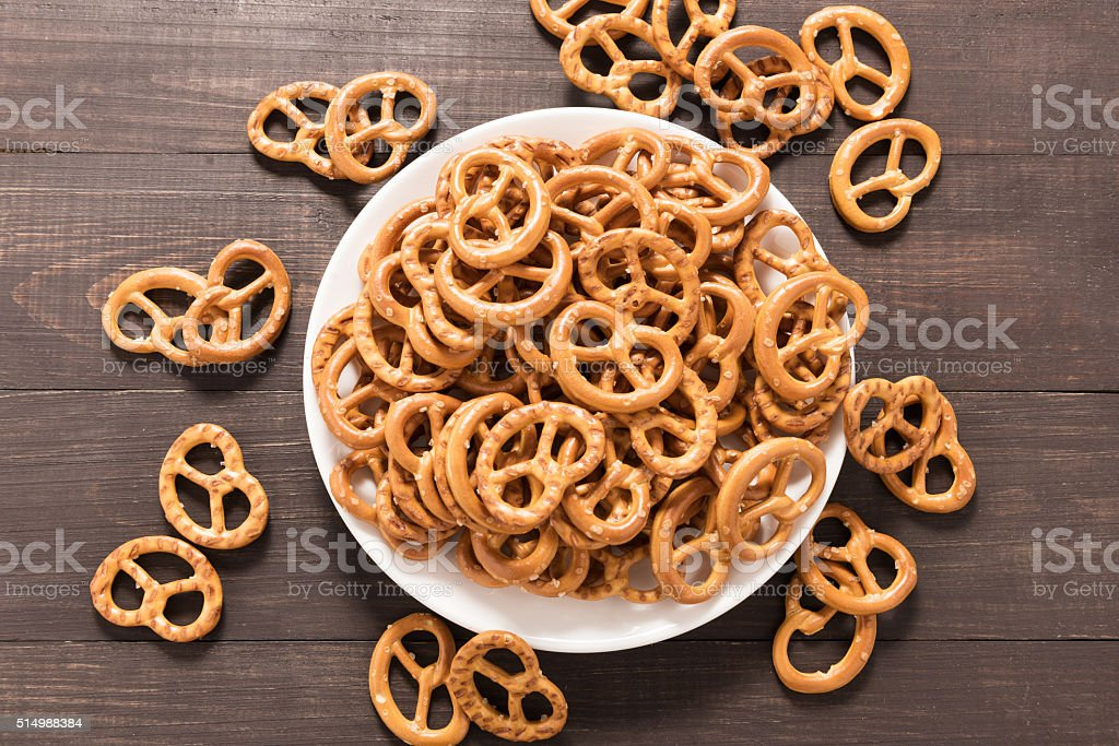 Pretzel in white dish on the wooden background stock photo