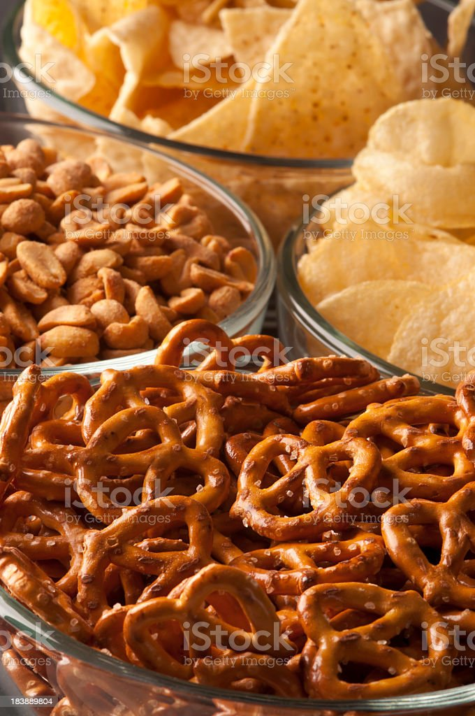 Pretzels, chips, and other game day snacks stock photo