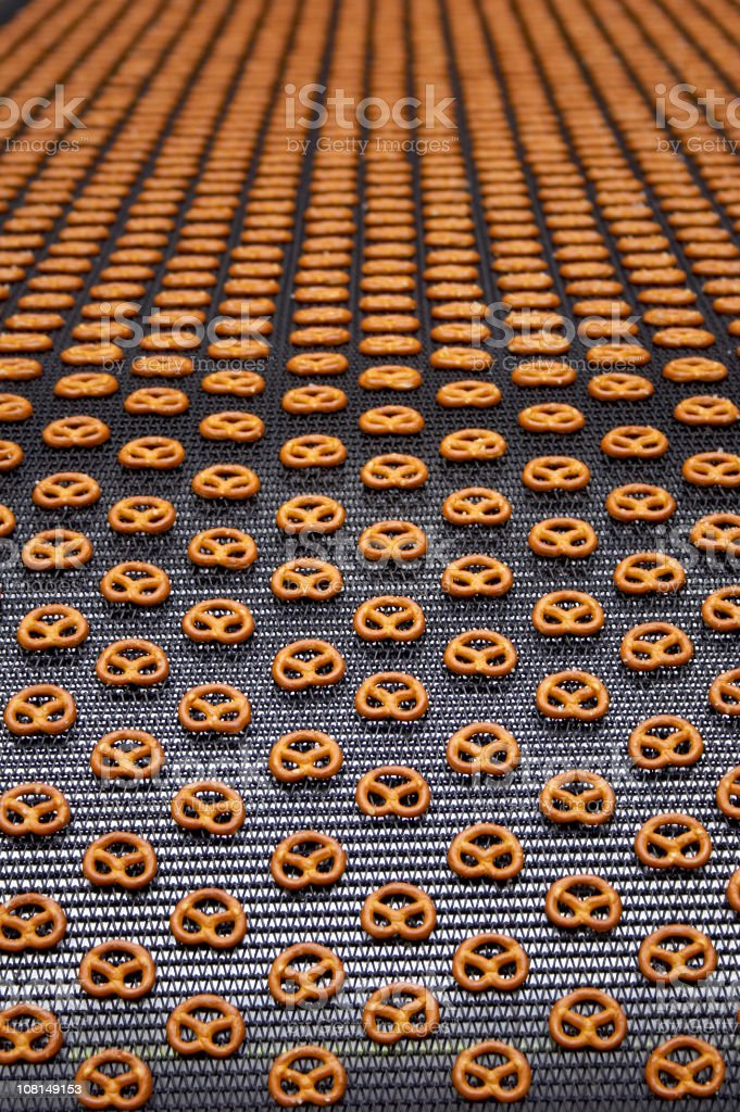 pretzels on conveyor belt in factory stock photo