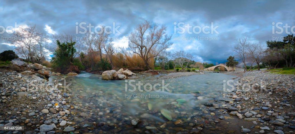 Preveli river with stone arch bridge. stock photo