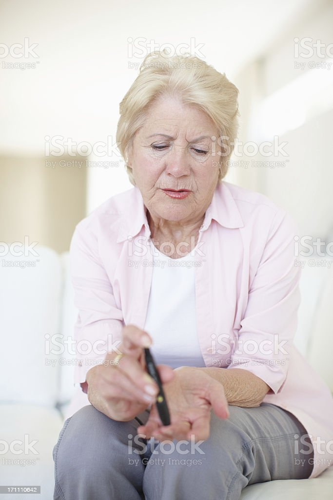 Prevention is part of a daily routine - Diabetes/Senior Health royalty-free stock photo