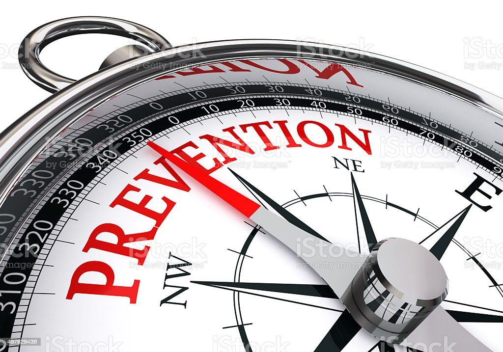 prevention red word on concept compass stock photo
