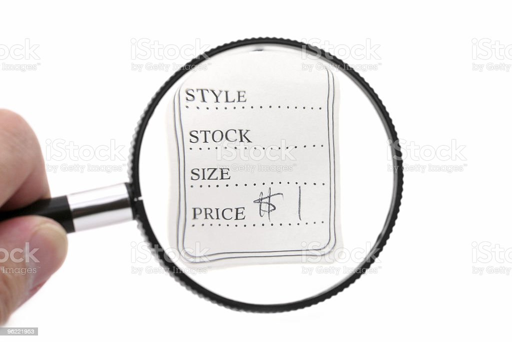 price tag and magnifier royalty-free stock photo