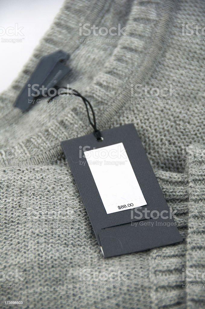 price tag on gray cardigan stock photo