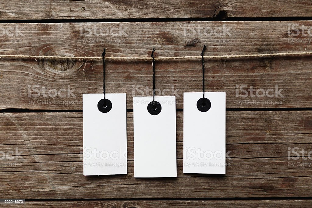 Price tag on wood hanging rope stock photo