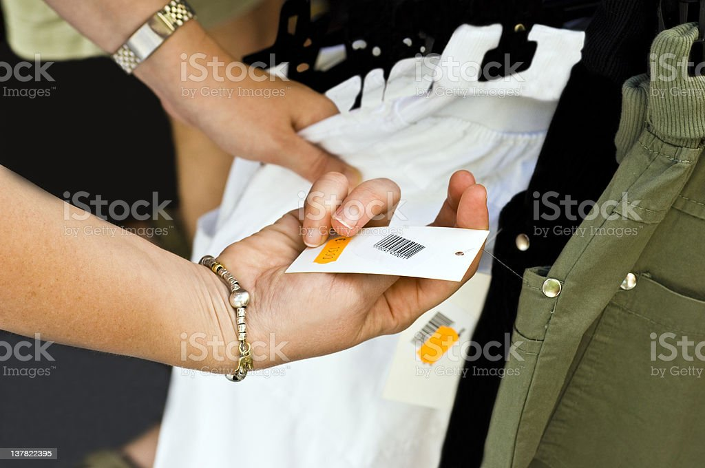 Price Tag with Hands. Color Image stock photo