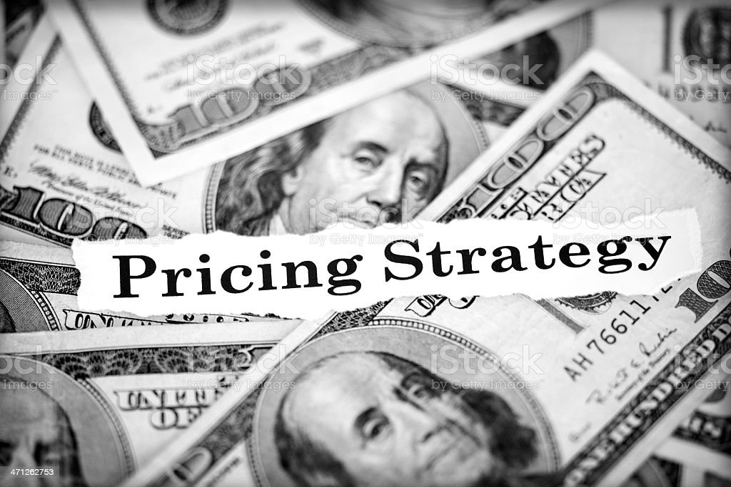 Pricing strategy text on 100 dollars stock photo