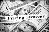 Pricing strategy text on 100 dollars