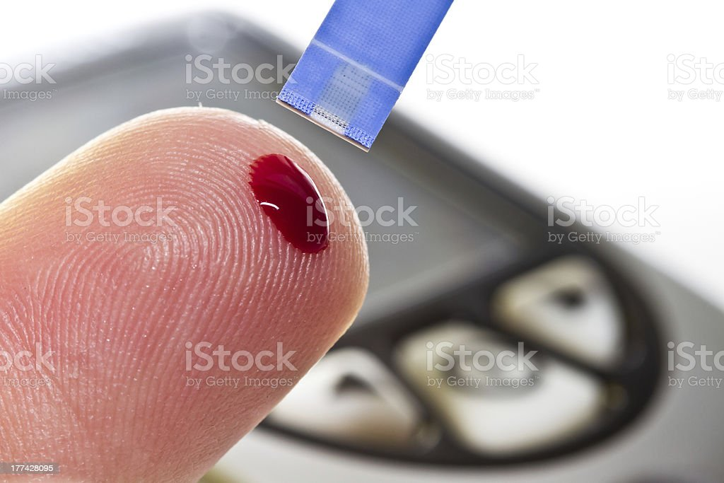Pricked Finger Bleeding to Check Glucose Level royalty-free stock photo