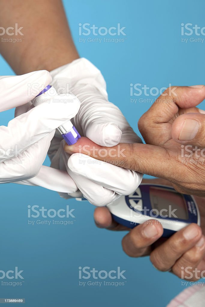 Pricking a Finger royalty-free stock photo