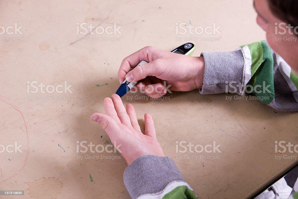 Pricking His Finger royalty-free stock photo