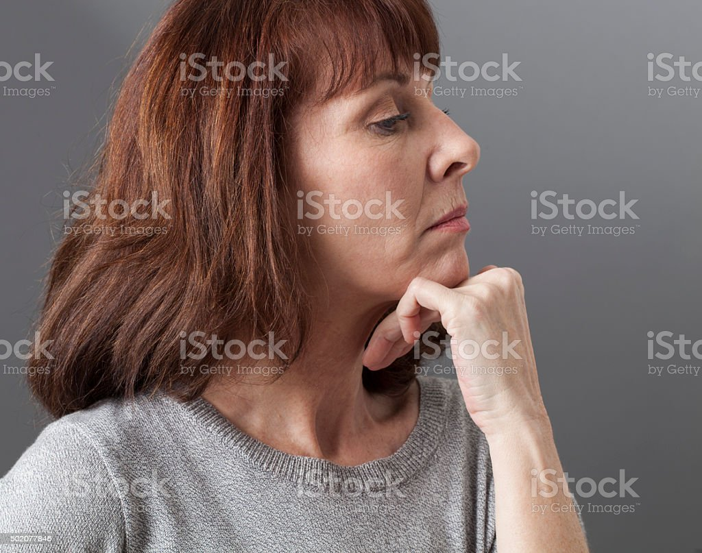 pride and arrogance for displeased 50s woman sulking stock photo