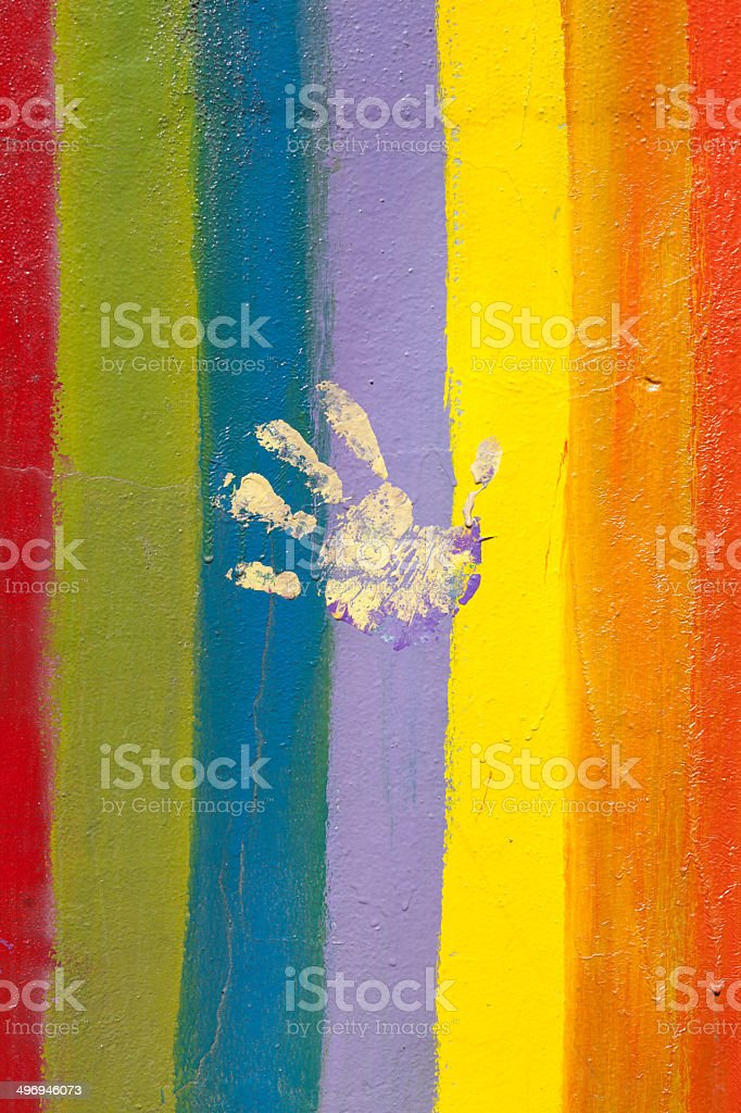 pride flag with hand print stock photo