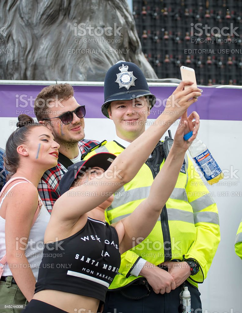 Pride Parade, People Taking Selfie With Police Officer stock photo