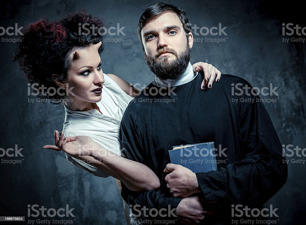 Priest and devil royalty-free stock photo