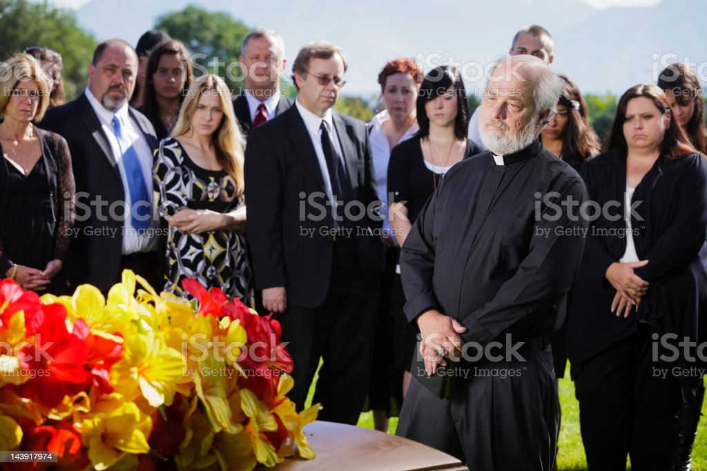 Priest at a Funeral royalty-free stock photo