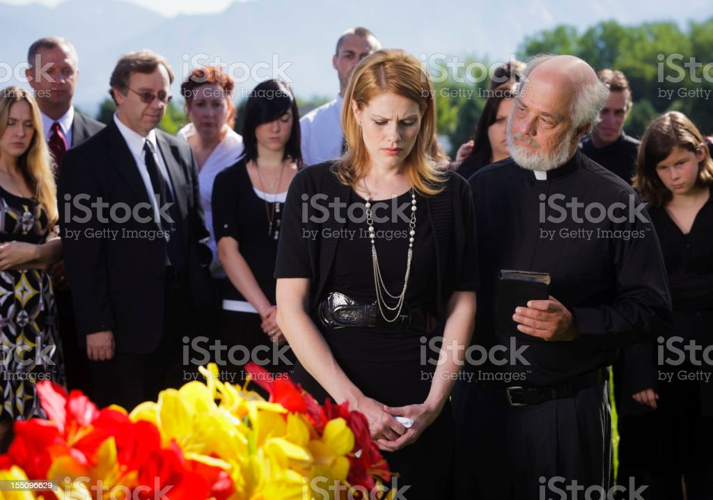 Priest at a Funeral stock photo