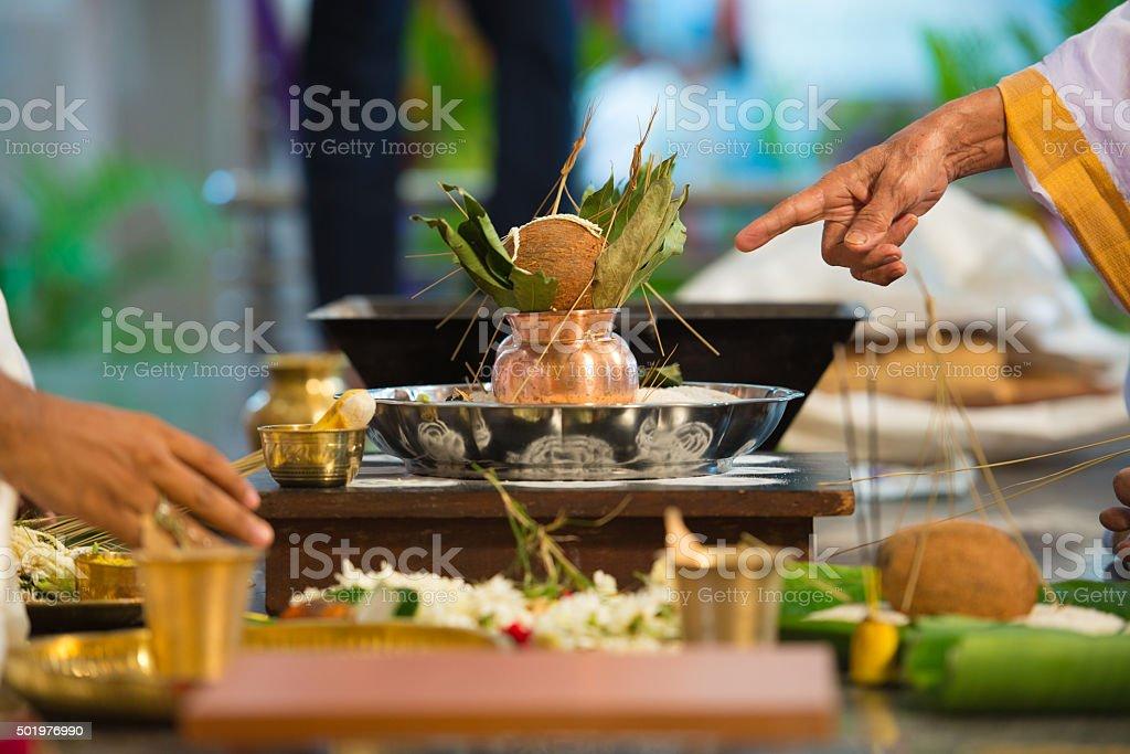 Priest chanting mantra - Indian Wedding stock photo