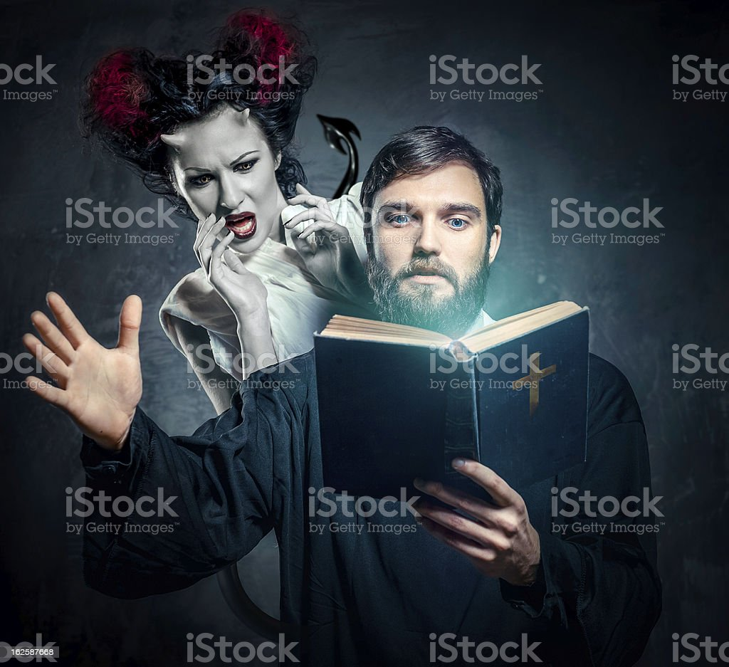 Priest evicting demons stock photo
