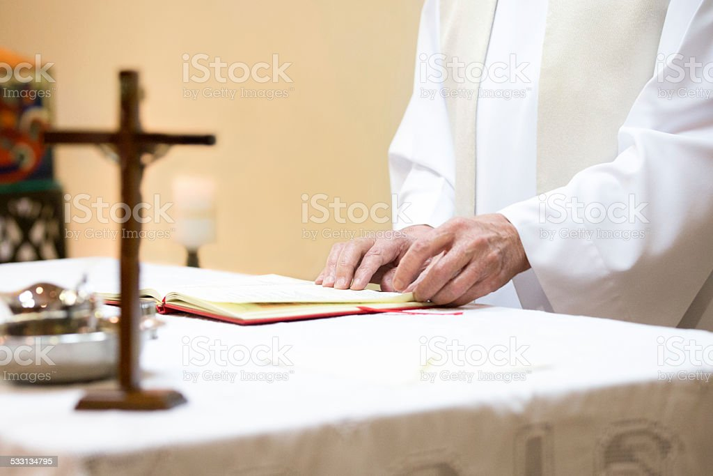 Priest hands close up in church stock photo