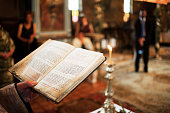 Priest holding bible in church