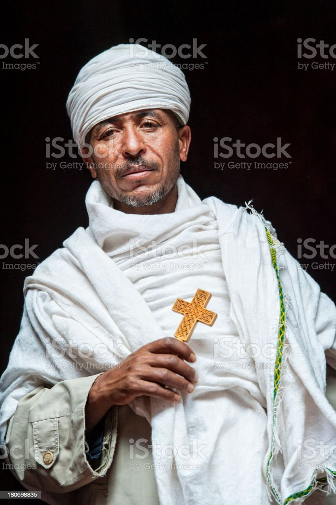 Priest inside a rock hewn church in Lalibela, Ethiopia stock photo