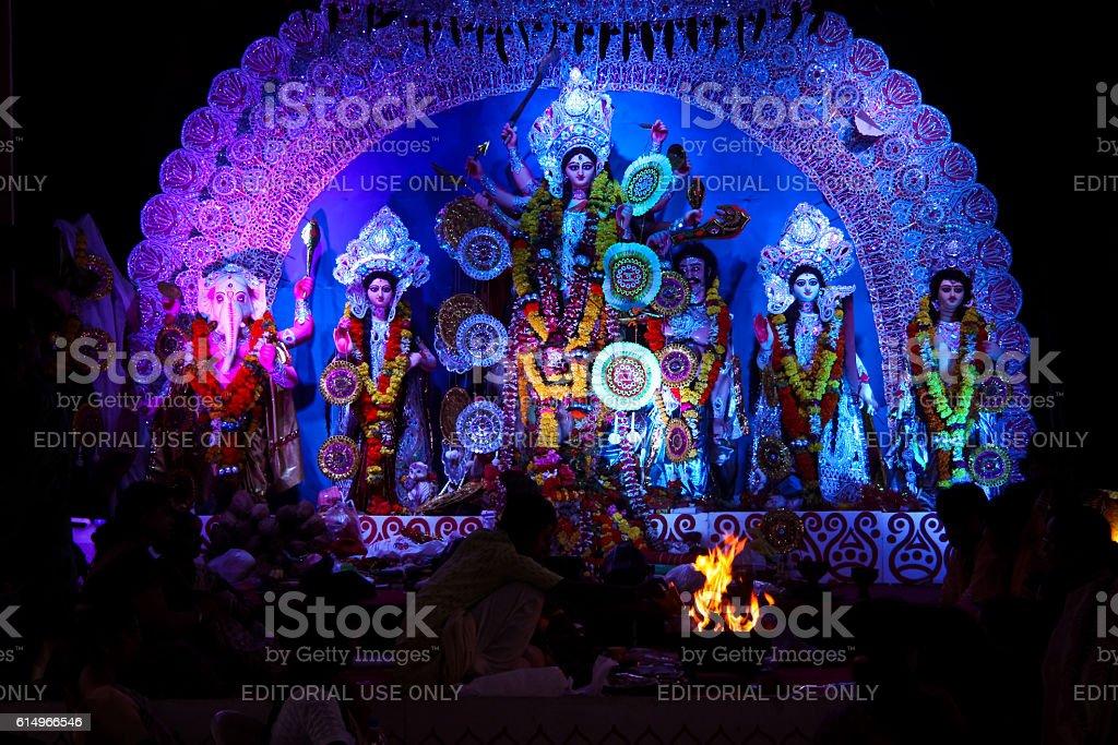Priest offering prayer at Durga Puja in Pune stock photo