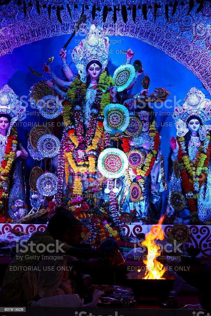 Priest offering prayer at Durga Puja in Pune stock photo