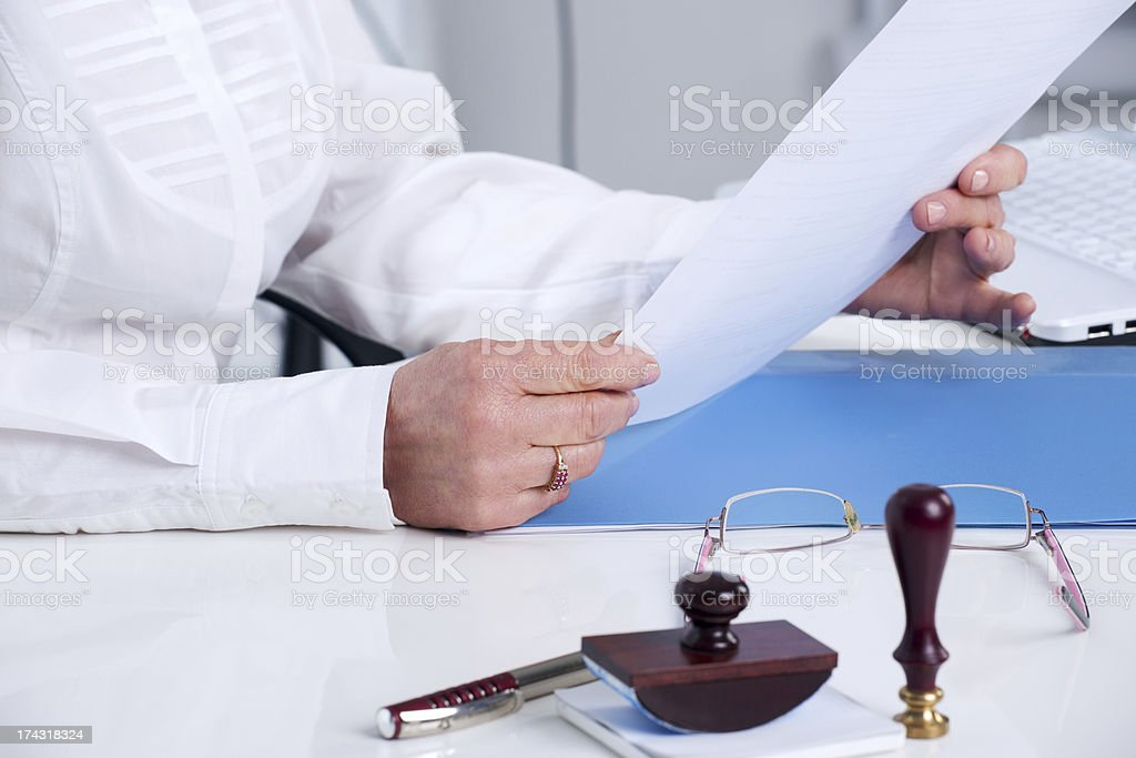 Priest overlooking a testament prior to signing royalty-free stock photo