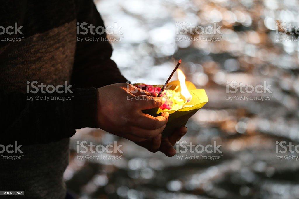 Priest performs religious Ganga Aarti ceremony at Har Ki Pauri stock photo