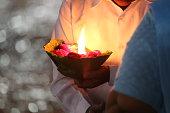 Priest performs religious Ganga Aarti ceremony at Har Ki Pauri