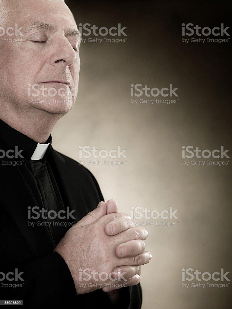 A priest praying stock photo