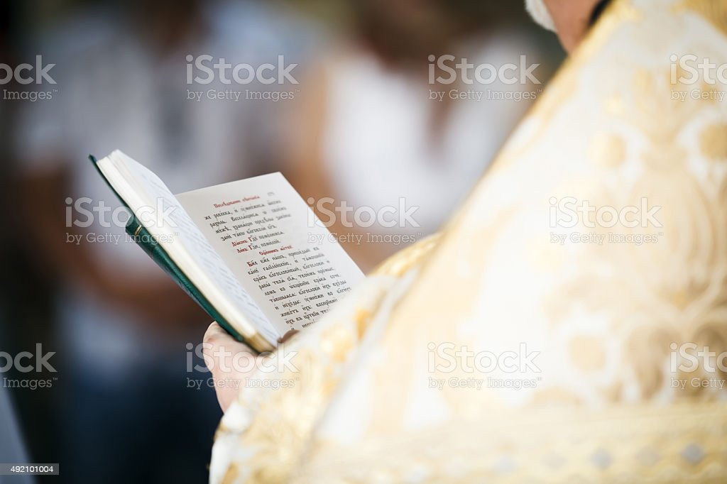 Priest read prayer-book. stock photo
