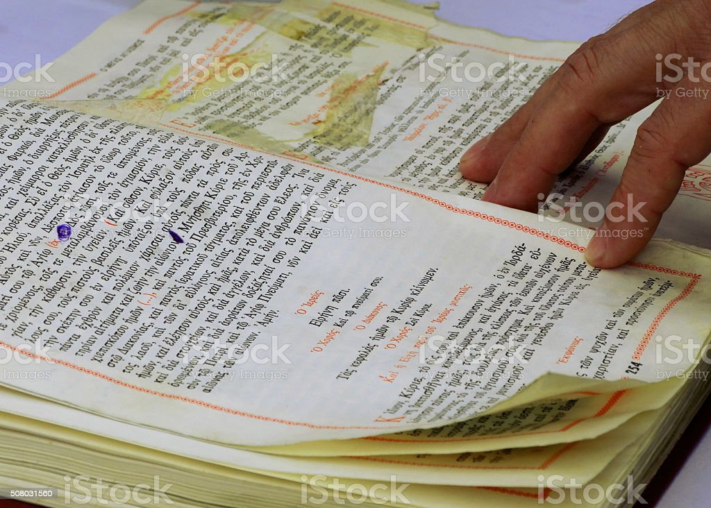 Priest's Hand On Greek Bible stock photo