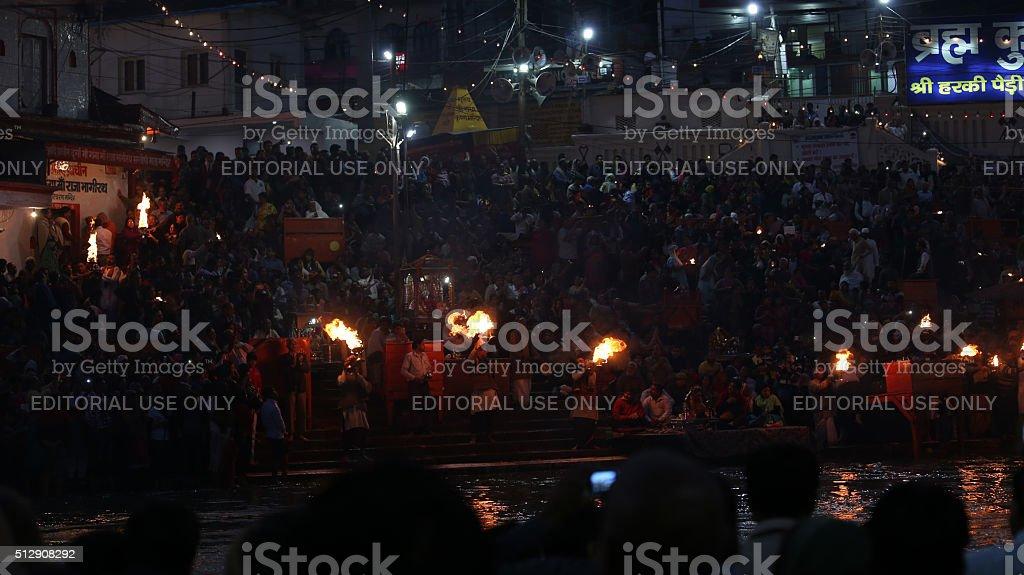 Priests performs religious Ganga Aarti ceremony at Har Ki Pauri stock photo