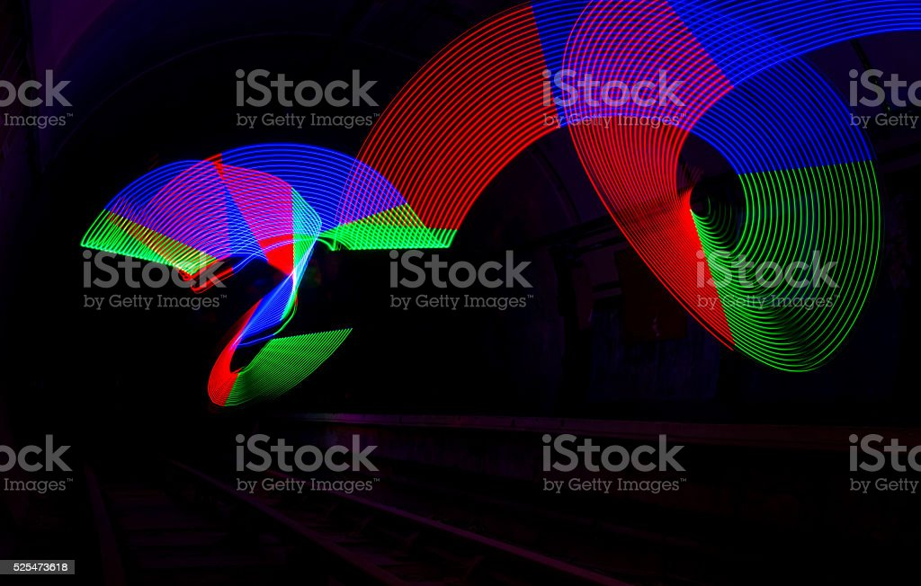 Primary colored LED lights lighting up a dark tunnel stock photo