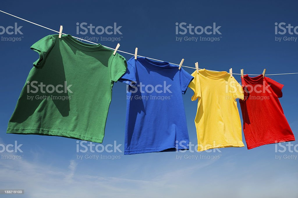 Primary Colored T-Shirts on a clothesline stock photo