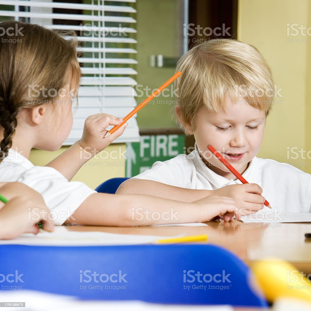 primary school: candid conversation royalty-free stock photo