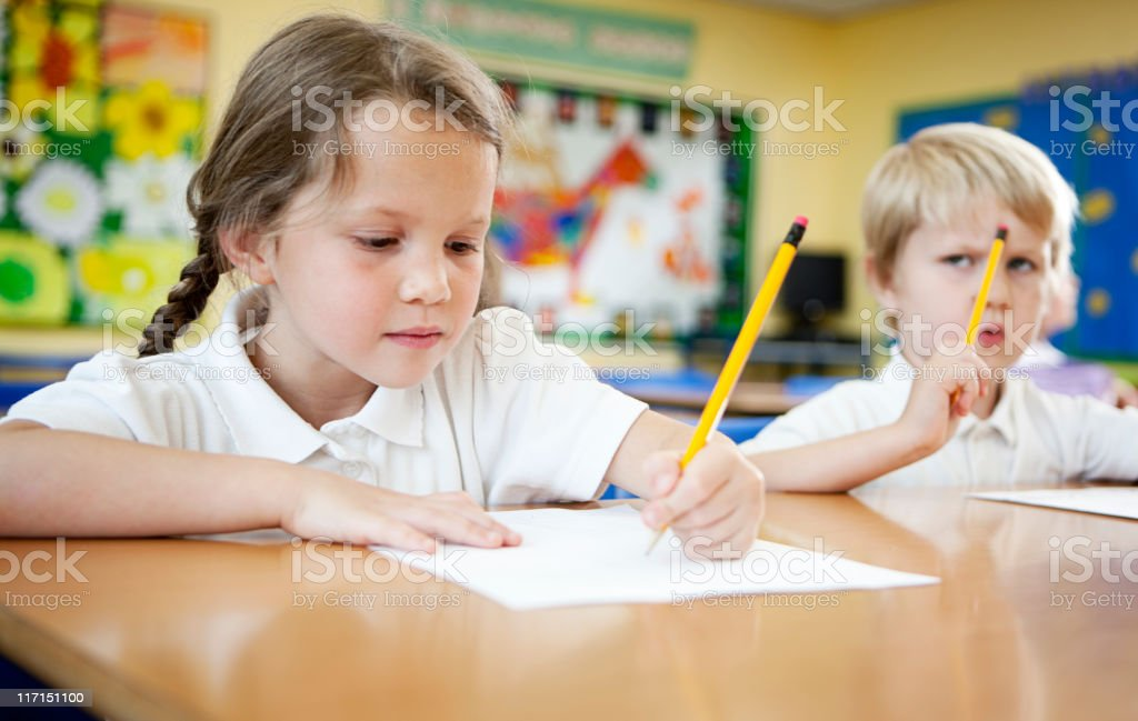 primary school: children concentrating on schoolwork. stock photo