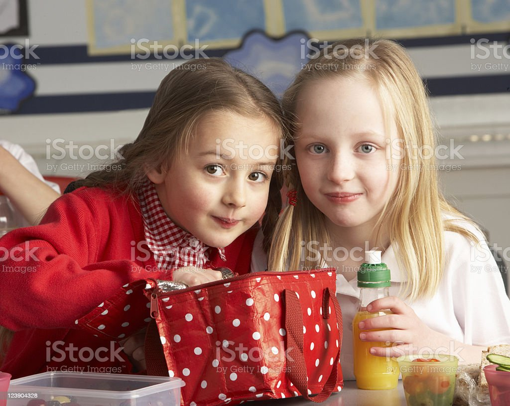 Primary School Pupils Enjoying Packed Lunch In Classroom royalty-free stock photo