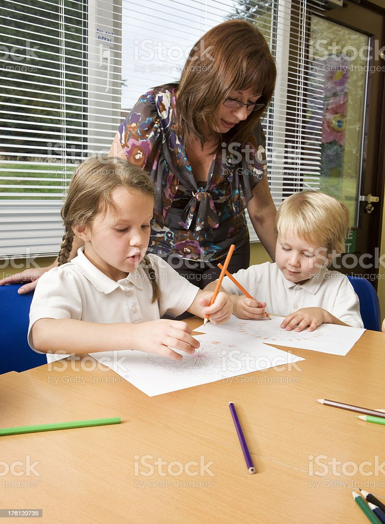primary school: teacher and pupils working together royalty-free stock photo