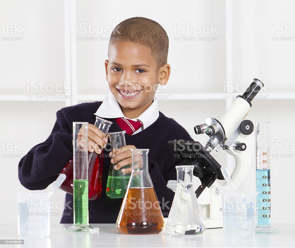 primary schoolboy in science lab royalty-free stock photo