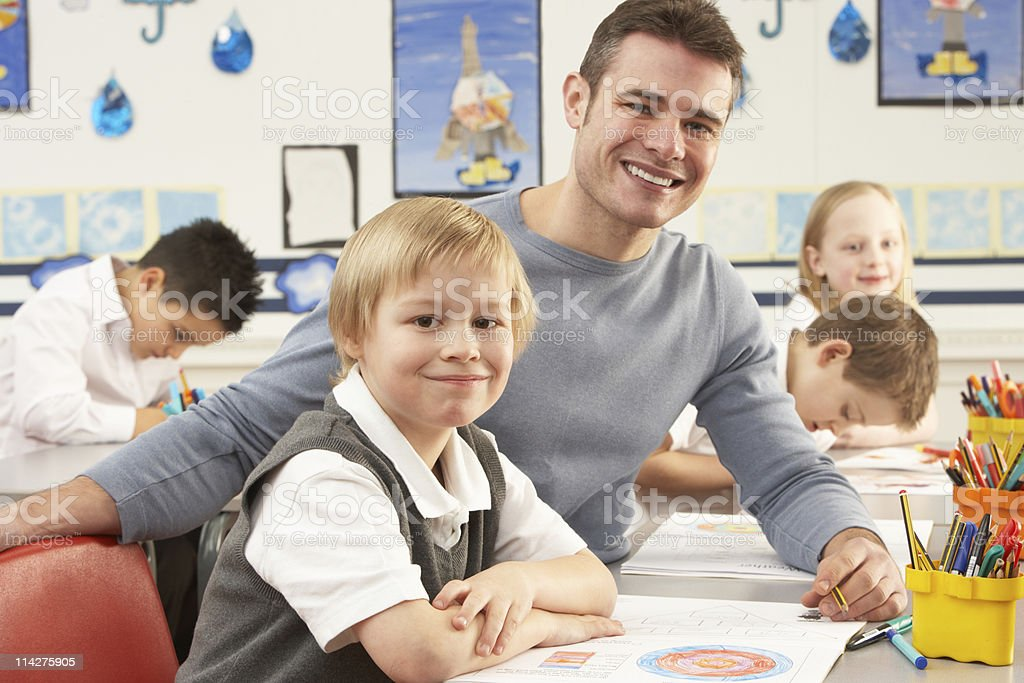 Primary Schoolchildren And Teacher Having lesson In Classroom royalty-free stock photo