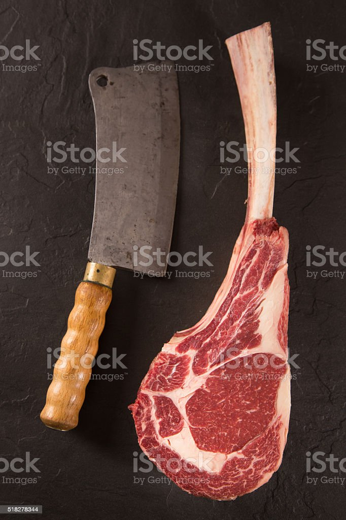 Prime Rib and meat cleaver stock photo